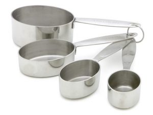 Steel dry measuring cups can be more durable and versatile than plastic ones.