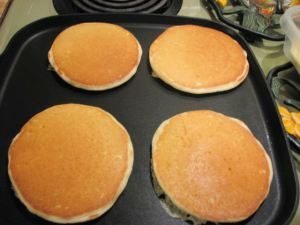 Pancakes on a griddle.