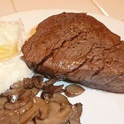 Filet Mignon and mushrooms in a balsamic and red wine glaze.