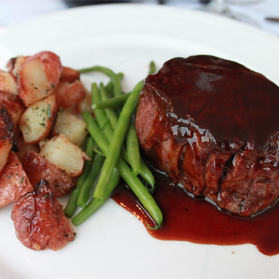 Filet Mignon with a Balsamic Vinegar Glaze served with red potatoes and string beans.