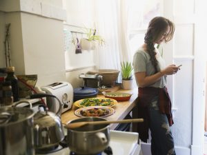 College student invents home cooking app after getting tired of fast food.