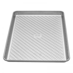 A textured surface half sheet pan makes for more even baking because it increases air circulation in the oven.